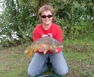 youngster with mirror carp